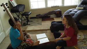 Amie teaching young vocal student